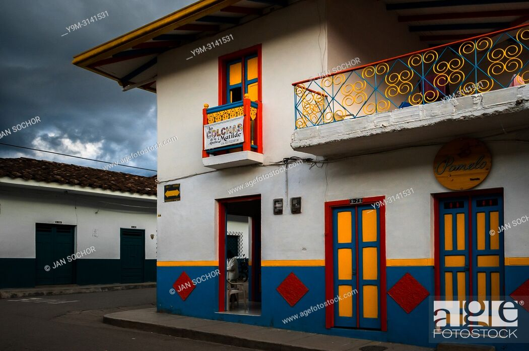 Stock Photo: A brightly painted colonial house is seen before a rain storm in Jardín, a village in the coffee region (Zona cafetera) of Colombia, 24 April 2018.