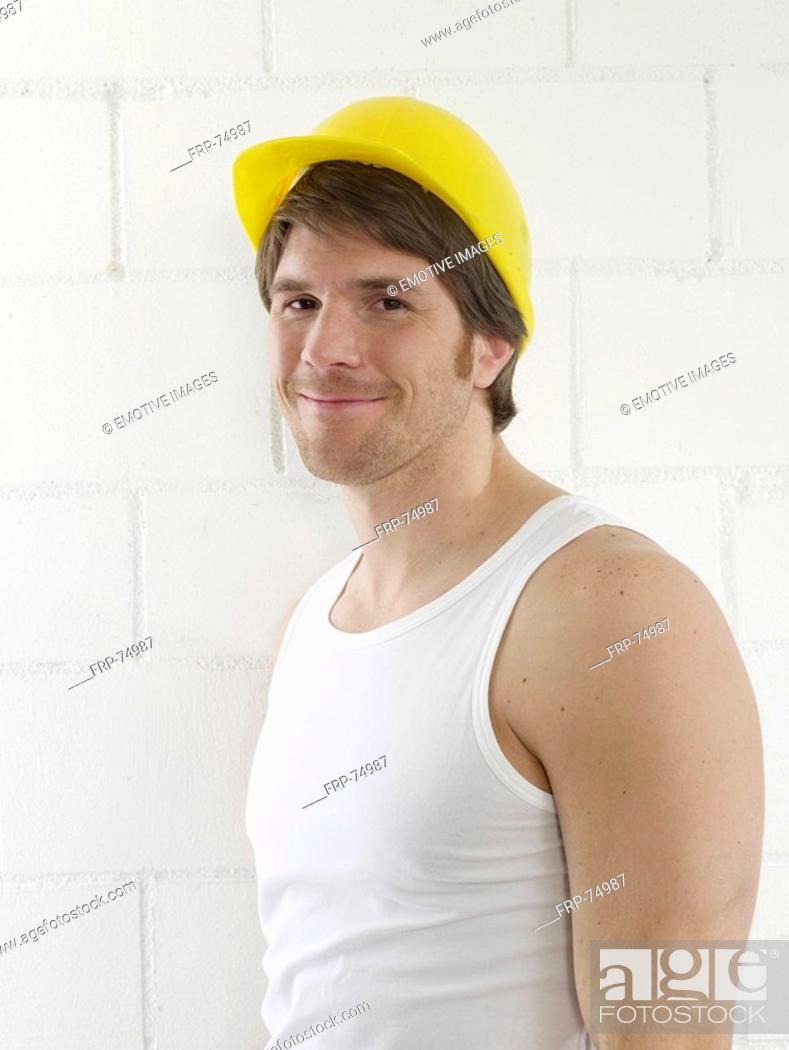 Stock Photo: Man wearing helmet and undershirt.