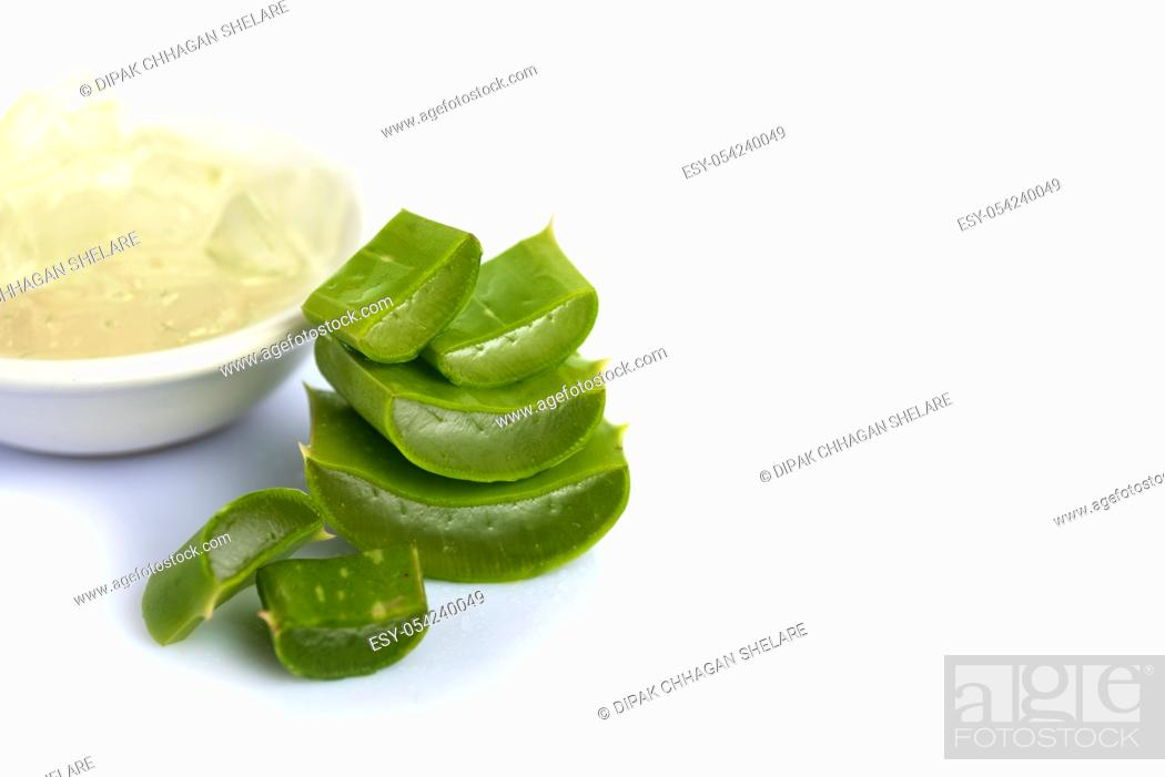 Stock Photo: Slices of Aloe Vera leaves and Aloe Vera gel on a white background. Aloe Vera is a very useful herbal medicine for skincare and hair care.