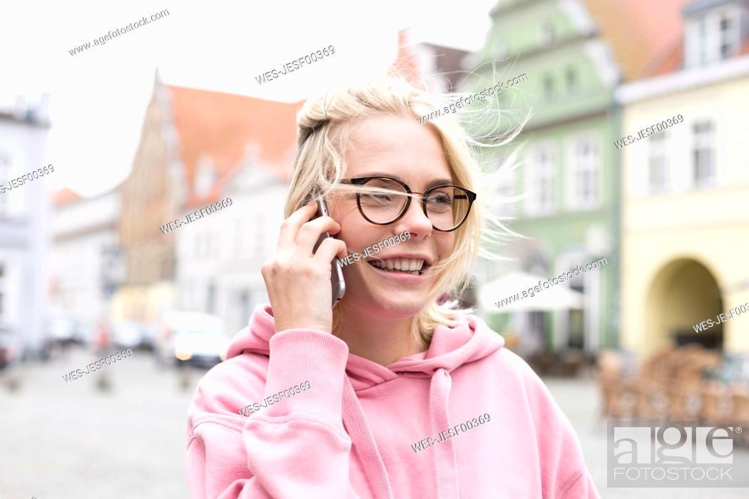 Stock Photo: Portrait of blond woman using smartphone.