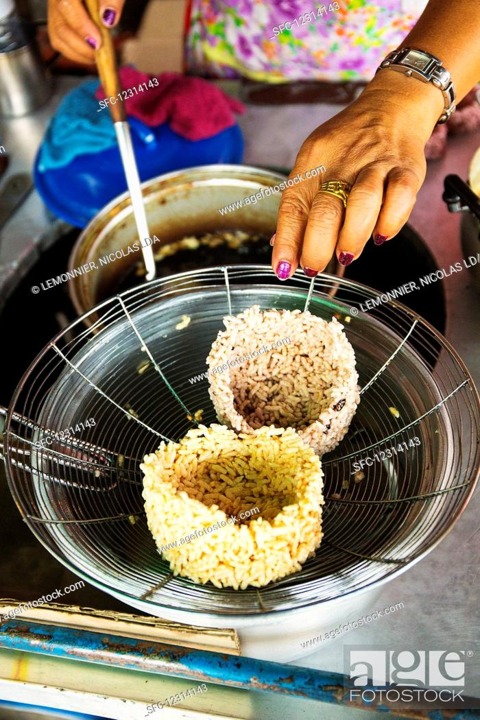 Stock Photo: Fried Thai rice bowls on a strainer.