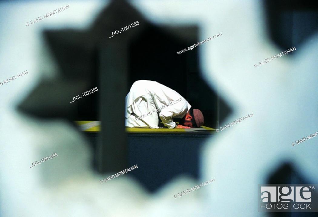 Stock Photo: Muslim man praying.