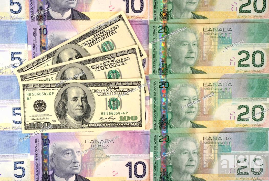 Stock Photo Various Canadian Dollar Banknotes With 100 U S Dollars Symbolic Image For Exchange Rate