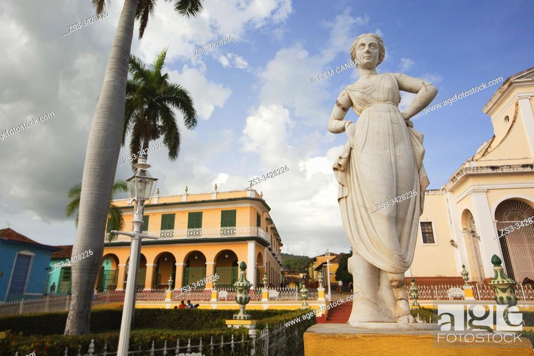 Stock Photo: View to the Museo Romantico-Romantic Museum with a statue in the foreground at the Main Square-Plaza Mayor, Trinidad, Sancti Spiritus Province, Cuba.