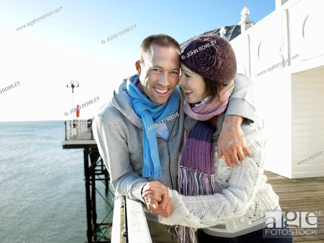Stock Photo: Couple holding hands standing on pier portrait.