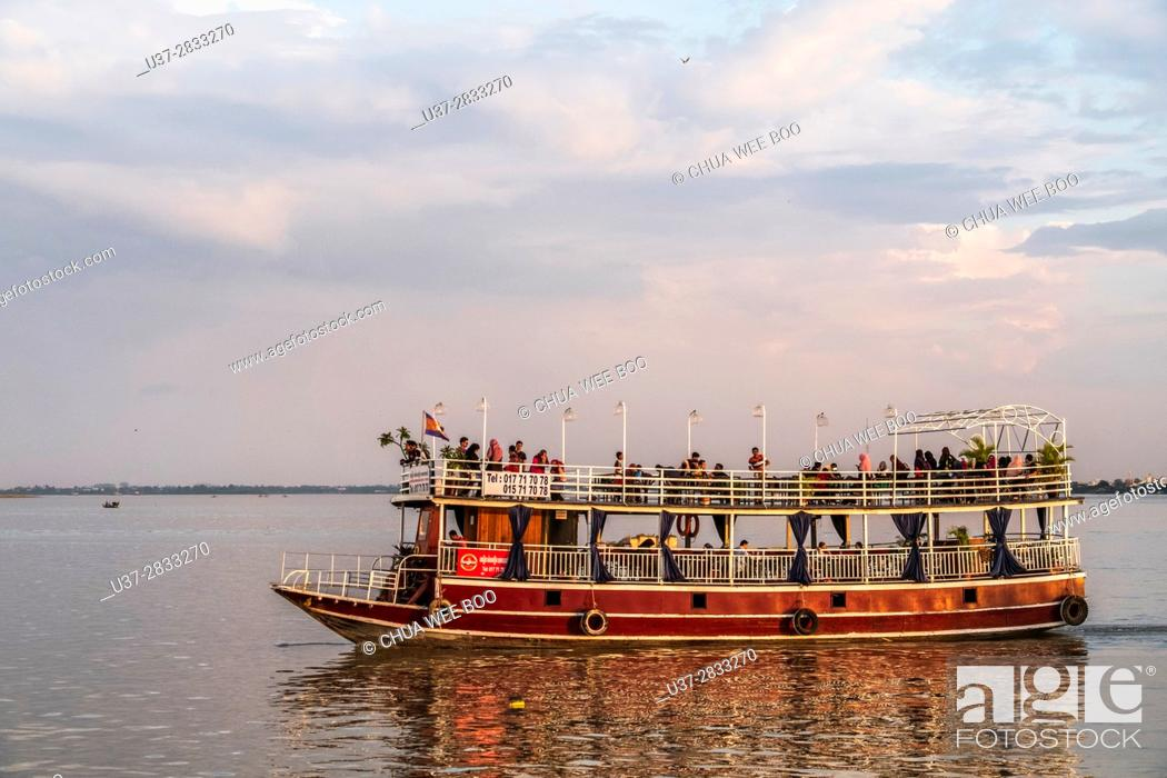 Stock Photo: Ferry on the Mekong River at Phnom Penh.