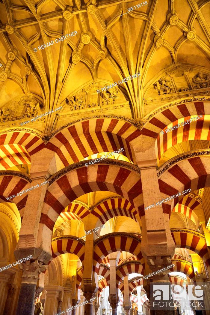 Stock Photo: Double arches and ceiling with Old Testament figures at the Hypostyle Prayer Hall in the Cordoba Cathedral Mosque.