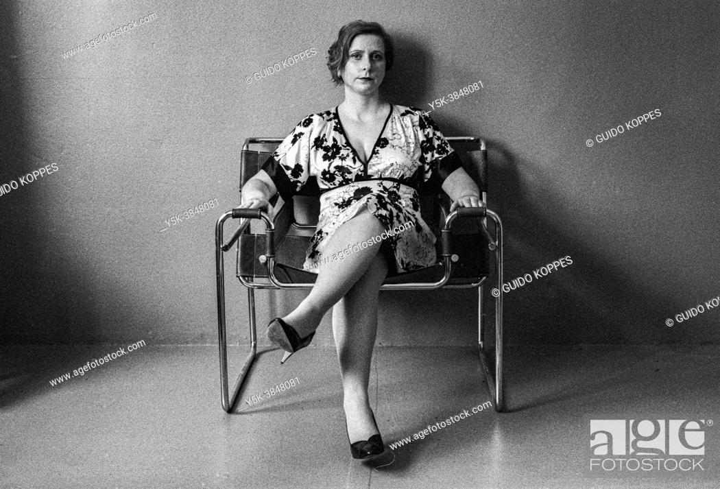 Stock Photo: Tilburg, Netherlands. Studio Portrait of an adult, caucasian woman in black and white. Studio Shot on Analog Black & White Film.