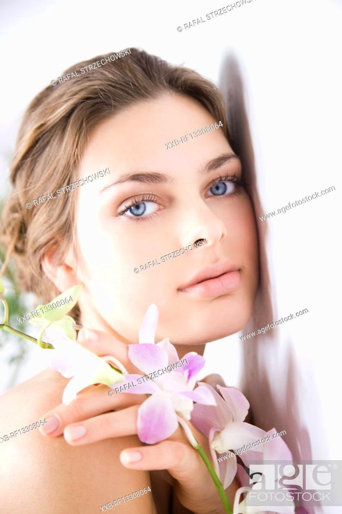 Stock Photo: woman with purple orchid.