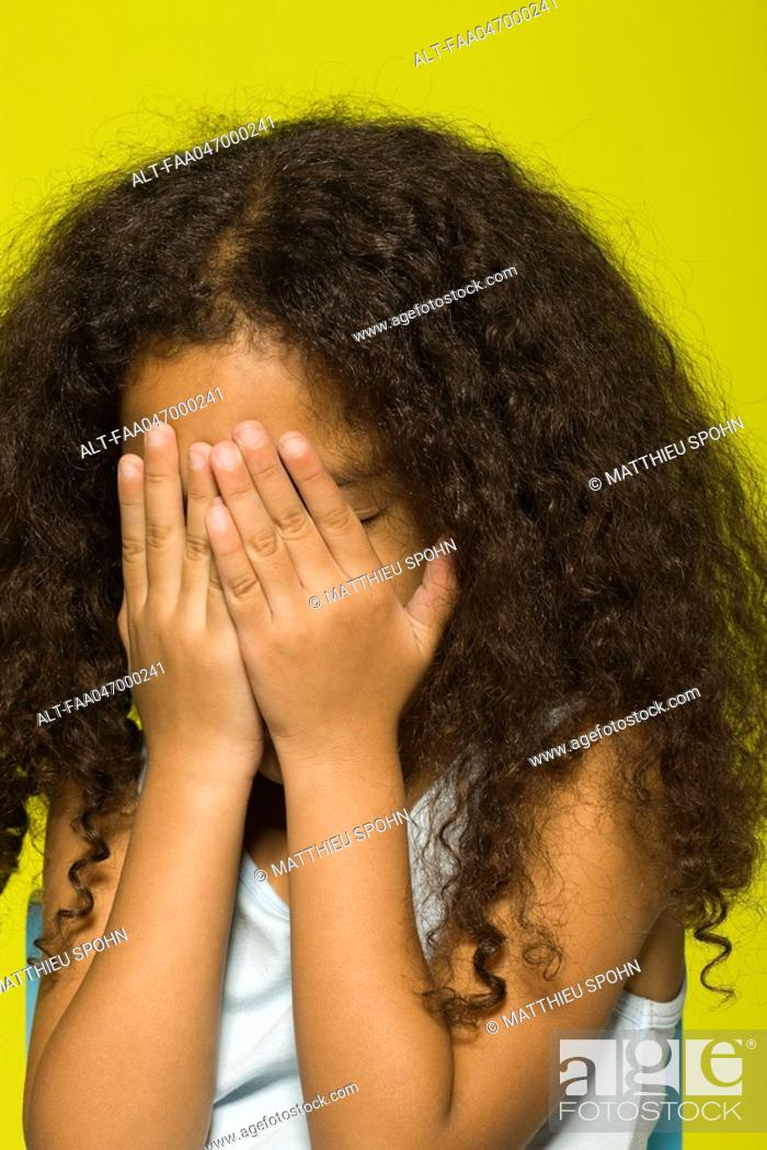 Stock Photo: Little girl covering face with hands.