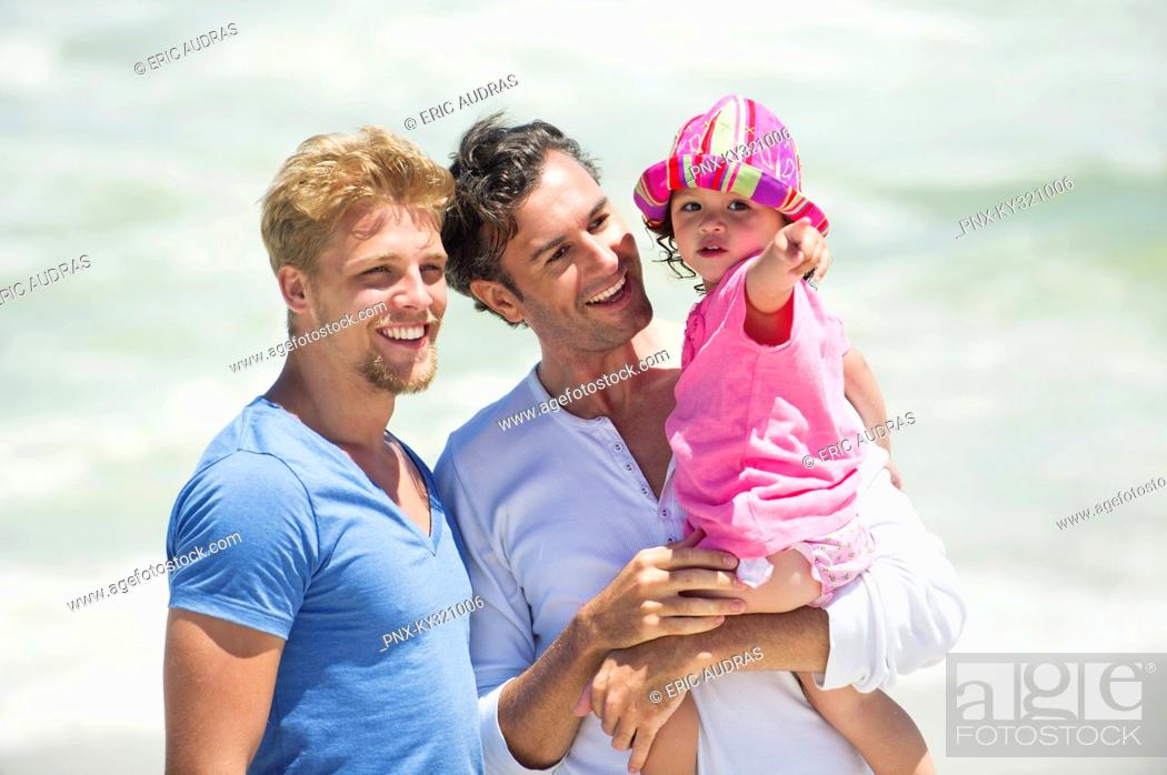 Stock Photo: Man carrying his daughter pointing.