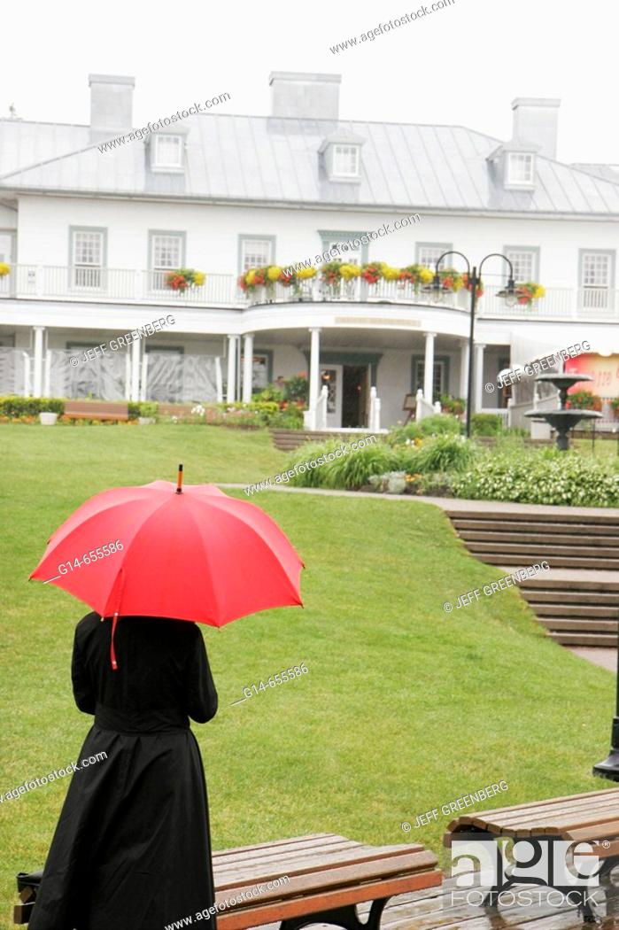 Stock Photo: Canada, Quebec City, Parc de la Chute-Montmoracy, Manoir Montmoracy, waterfall park, woman, red umbrella, villa manor,.