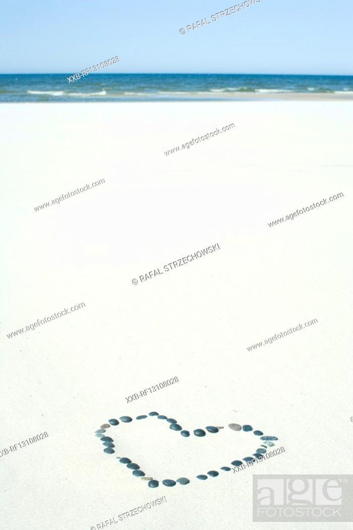 Stock Photo: heart on beach.