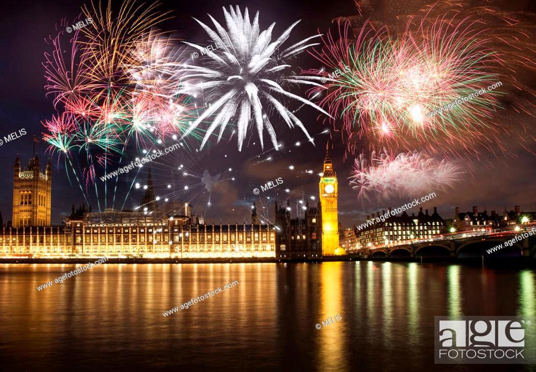 Stock Photo: Explosive fireworks display fills the sky around Big Ben. New Year's Eve celebration background.