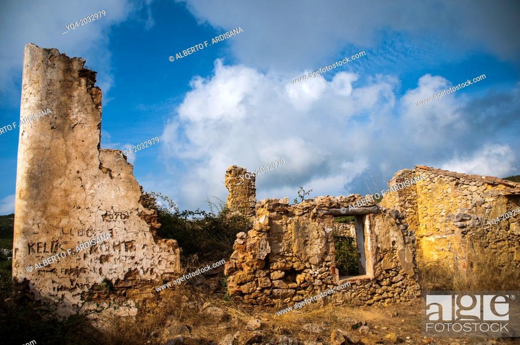 Stock Photo: House in ruins with clouds background in the province of Tarragona. Catalonia. Spain.