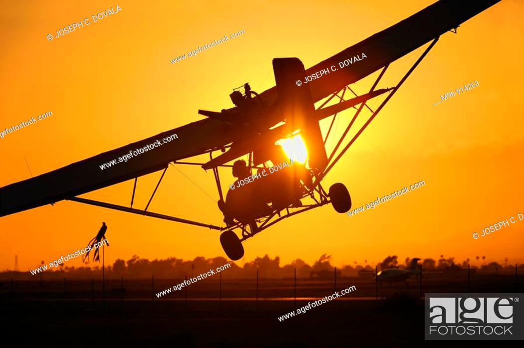 Stock Photo: Dual seat ultralight coming in for landing at sunset, Camarillo Airport, Camarillo, California, USA.