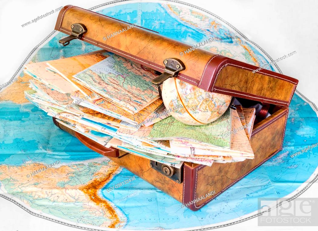 Stock Photo: Suitcase and maps of different countries isolated on white background.