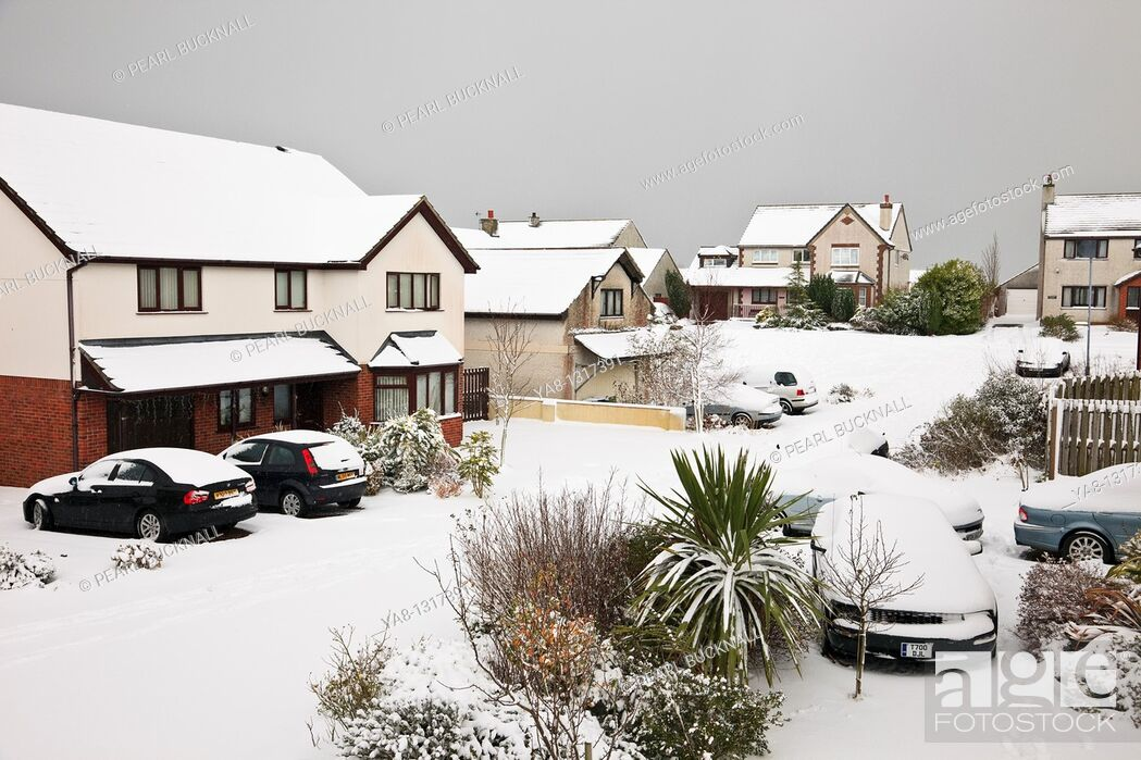 Stock Photo: Benllech, Anglesey, North Wales, UK, Europe  Snow on suburban estate street and houses during heavy winter snowfall.