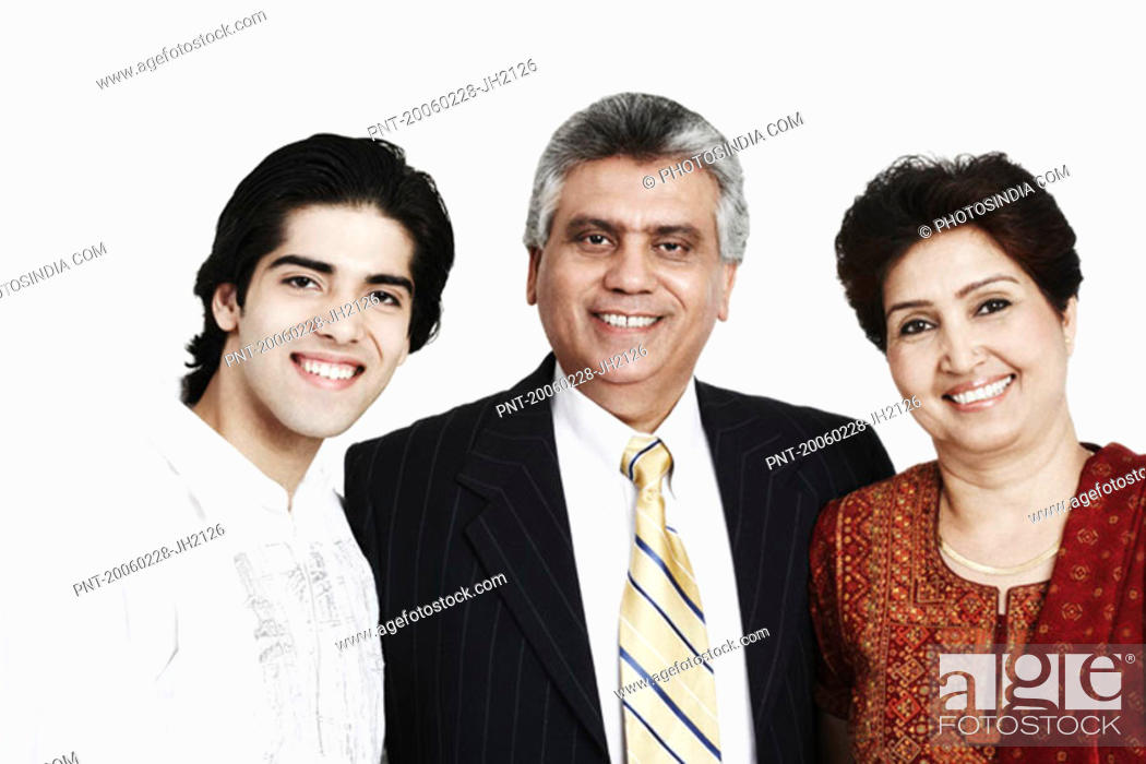 Stock Photo: Portrait of a mature couple standing with their son smiling.