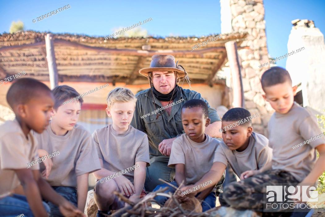 Photo de stock: Children learning how to make a fire.