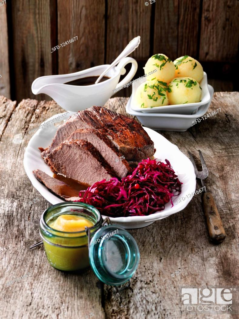 Stock Photo: Sauerbraten with potato dumplings and red cabbage.