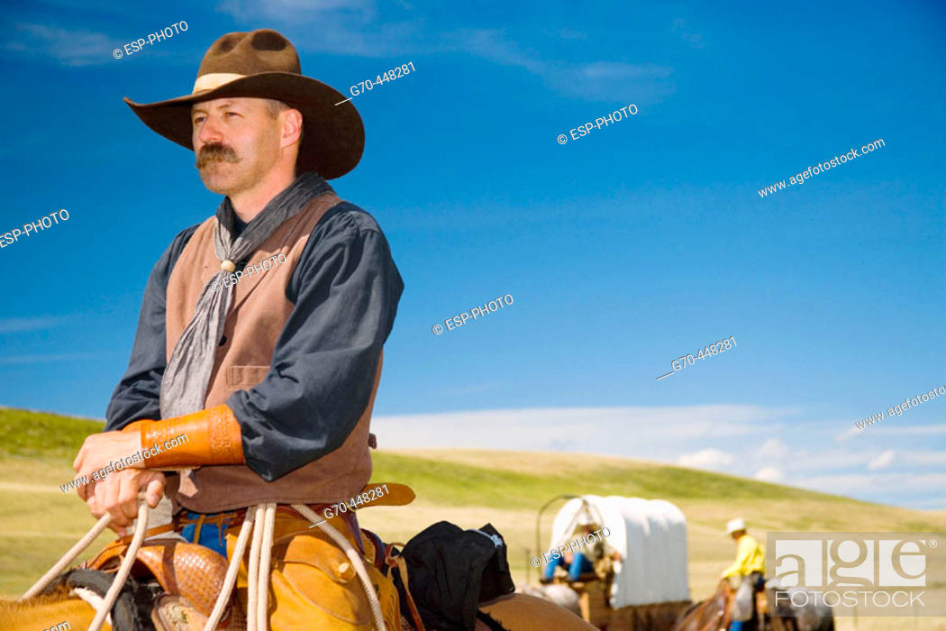 Stock Photo: Cowboys and chuck wagon. Porcupine Hills. Southern Alberta. Canada.