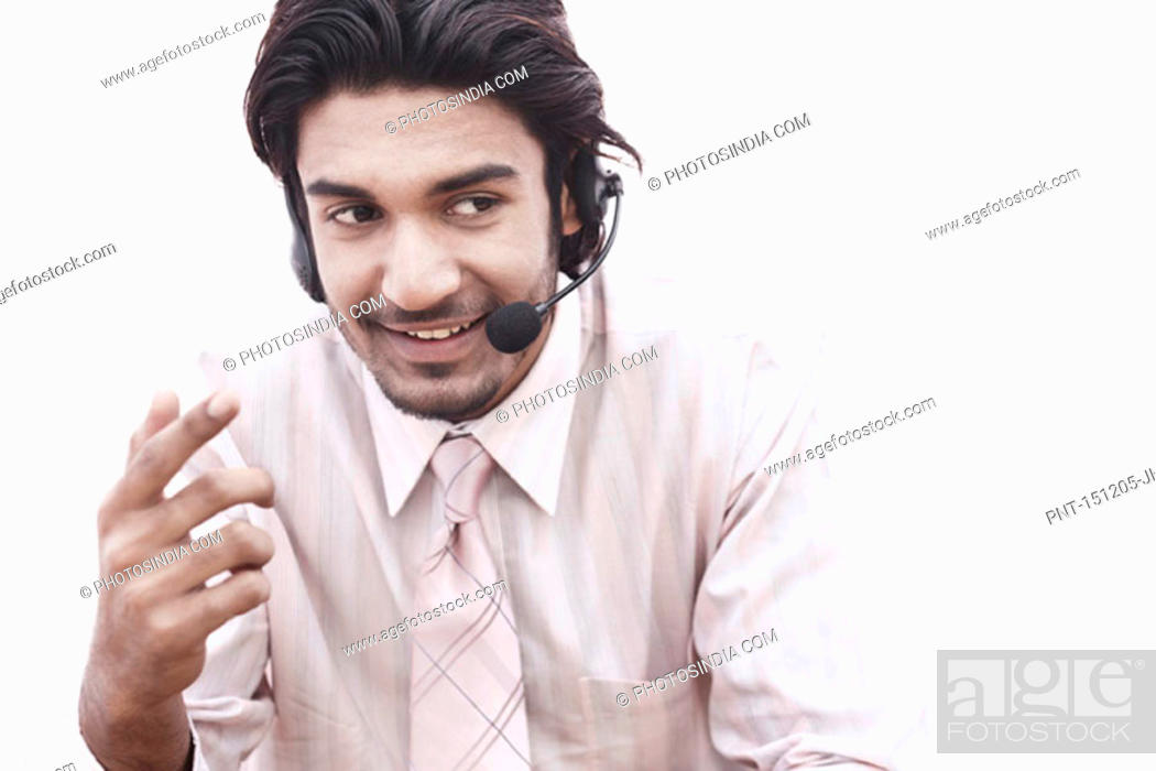 Stock Photo: Close-up of a businessman wearing a hands free device.