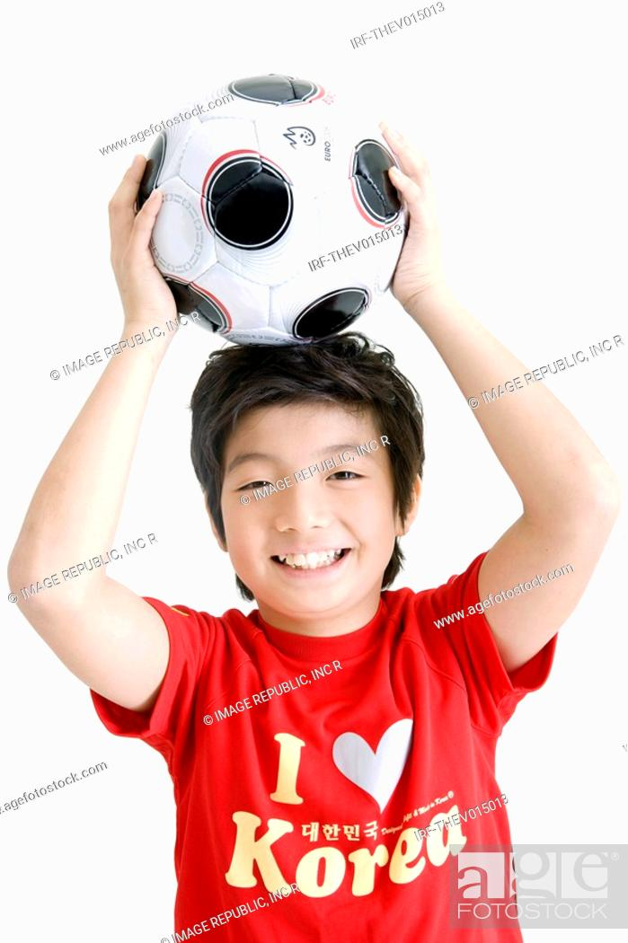 Stock Photo: boy holing soccer ball and Korean flag, Taegeukgi.