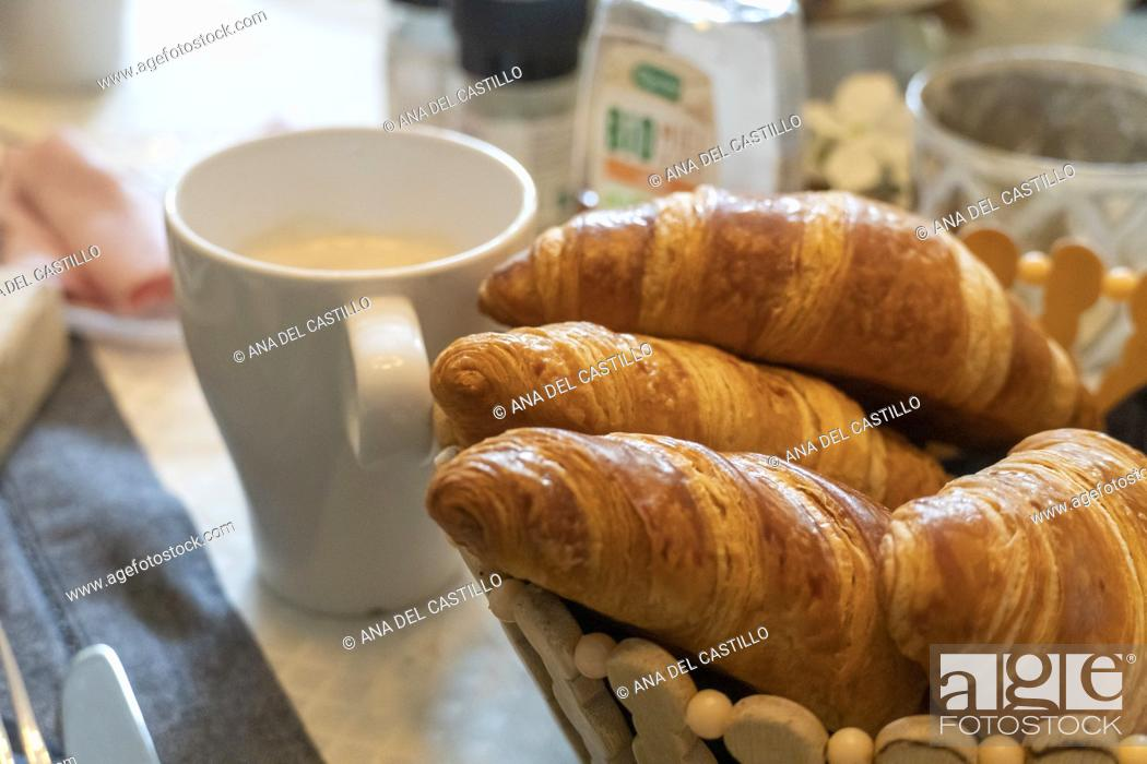 Stock Photo: Croissants with coffee cup on breakfast table France.