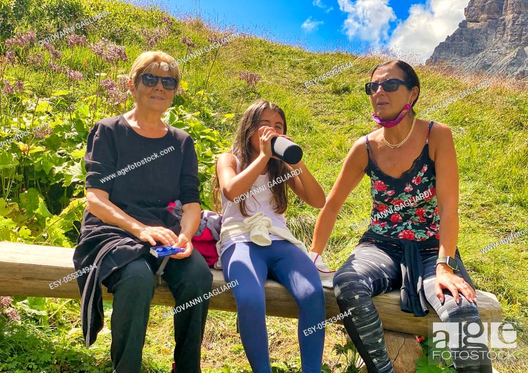 Photo de stock: Three generations female on a mountain excursion.