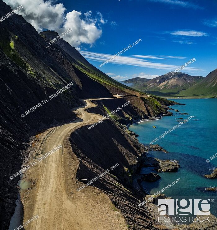 Stock Photo: Empty, curvy road, Njardvikurskridur mountain pass, Borgarfjordur Eystri, Iceland. This image is shot using a drone.