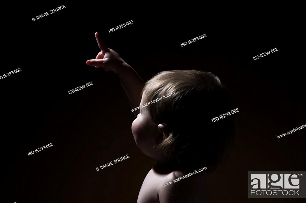Stock Photo: A baby girl pointing.