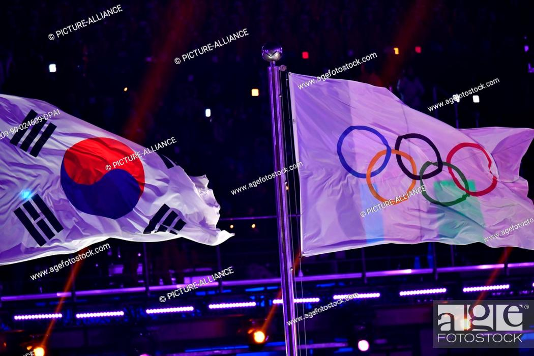 Stock Photo: The South Korean and Olympic flags fly at the opening ceremony of the Winter Olympics in Pyeongchang, South Korea, 9 February 2018.