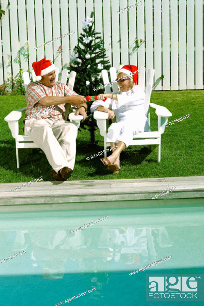 Stock Photo: Celebrating Christmas by the swimming pool.