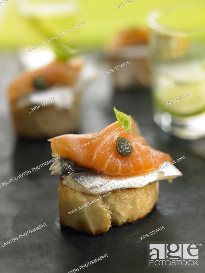 Photo de stock: montadito de boqueron y salmon ahumado / montadito of boqueron and smoked salmon.