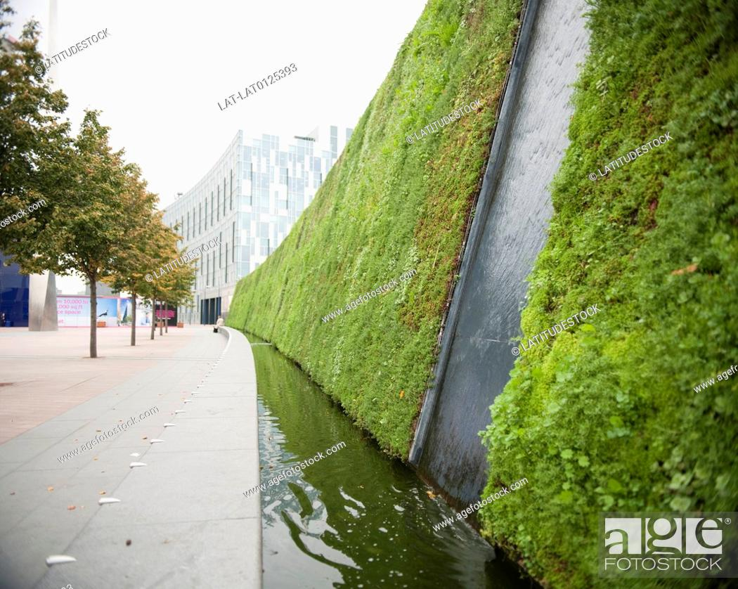 Delicieux Stock Photo: There Is A Large Living Wall Planted With Grass And Plants And  A