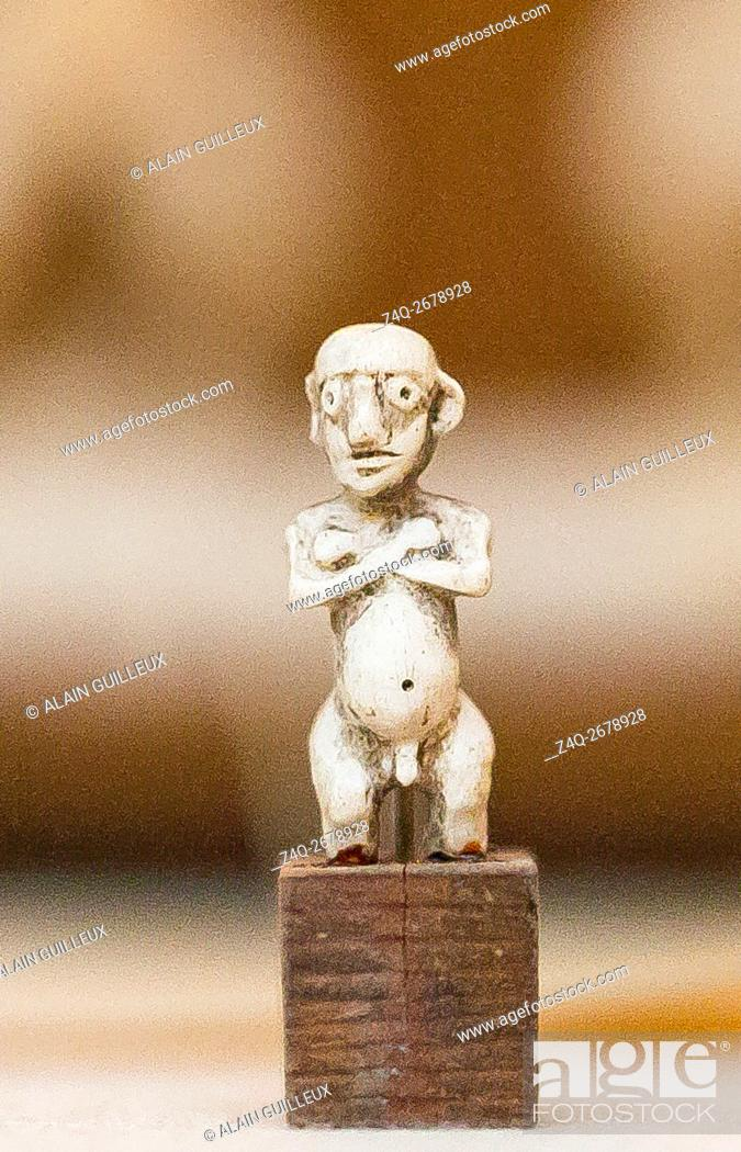 Stock Photo: Egypt, Cairo, Egyptian Museum, very small statuette of a dwarf, in ivory.