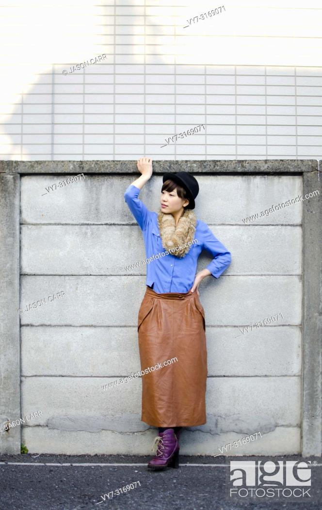 Stock Photo: Japanese Girl poses on the street in Shimo-Kitazawa, Japan. Shimo-Kitazawa is a town located in Tokyo.