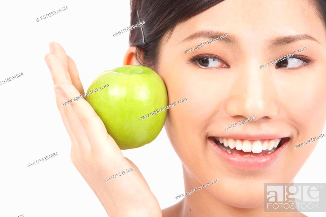 Stock Photo: Portrait of Natural Young girl Holding Apple.