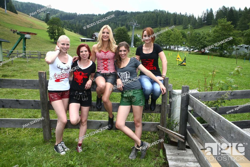 German folk music singer Stefanie Hertel (C) poses with her band