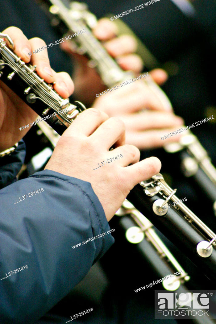 Stock Photo: Hands of clarinet players in a band.