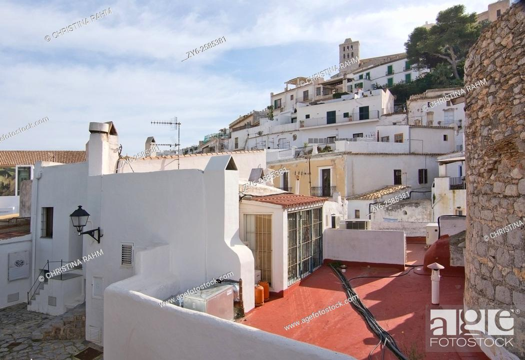 Stock Photo: White residential buildings with electrical cord in Eivissa Old Town Dalt Vila in Ibiza, Balearic islands, Spain.