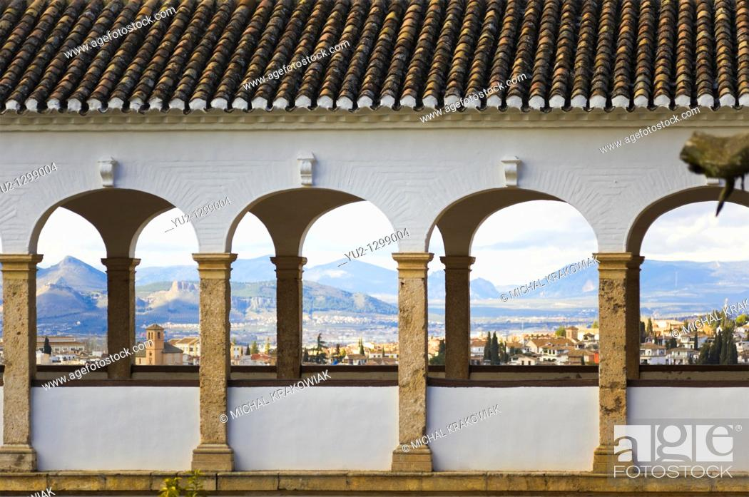 Stock Photo: Detail of palace in Generalife, Alhambra with panorama of Granada behind columns.
