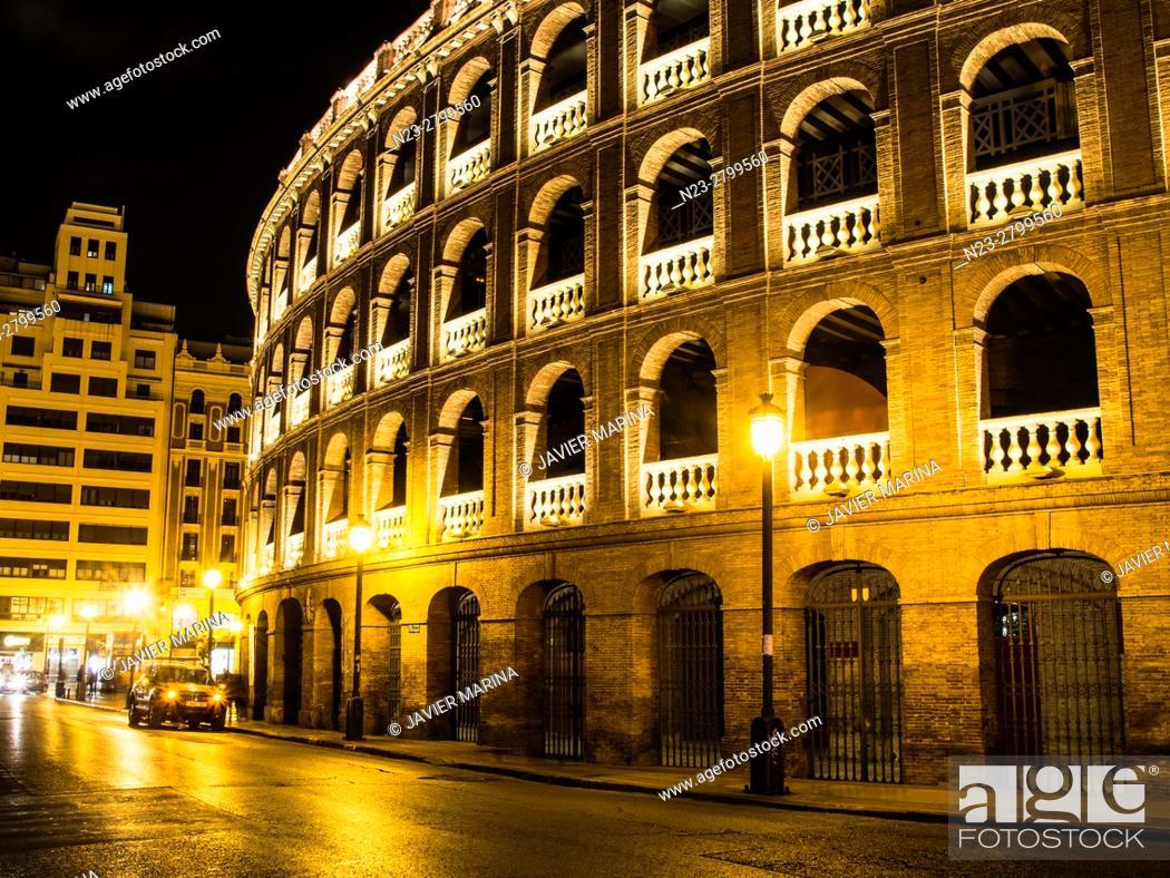 Stock Photo: Bullring illuminated at night, Valencia, Spain.