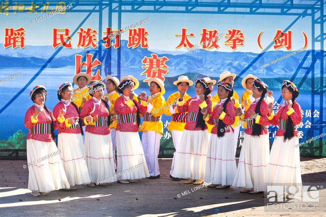 Stock Photo: Mosuo women dancing, wearing traditional costume, Lijiang, Yunnan Province, China.