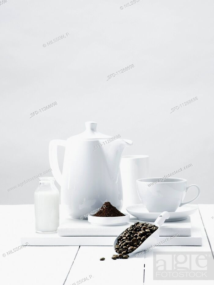 Stock Photo: An arrangement of coffee beans, ground coffee and coffee crockery.