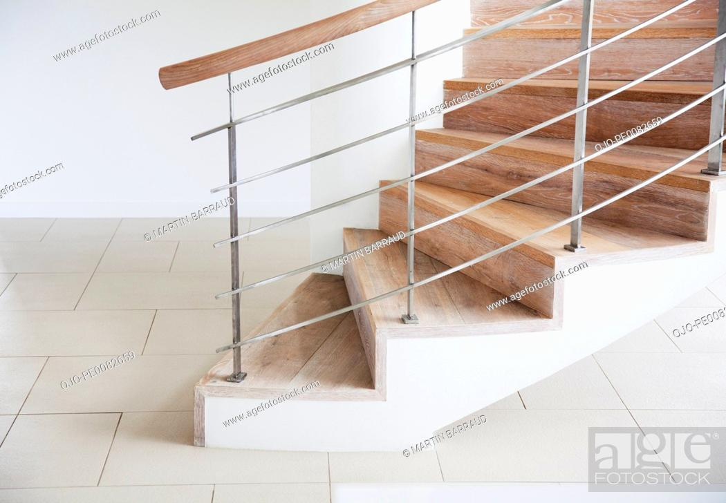 Stock Photo: Wooden staircase and railing in modern house.