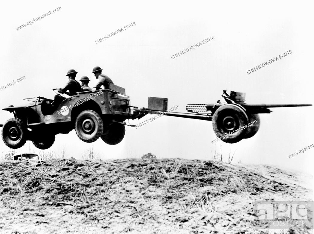 Stock Photo: The new 'jeep' in mid-air as it pulls a small artillery piece ca. 1941.