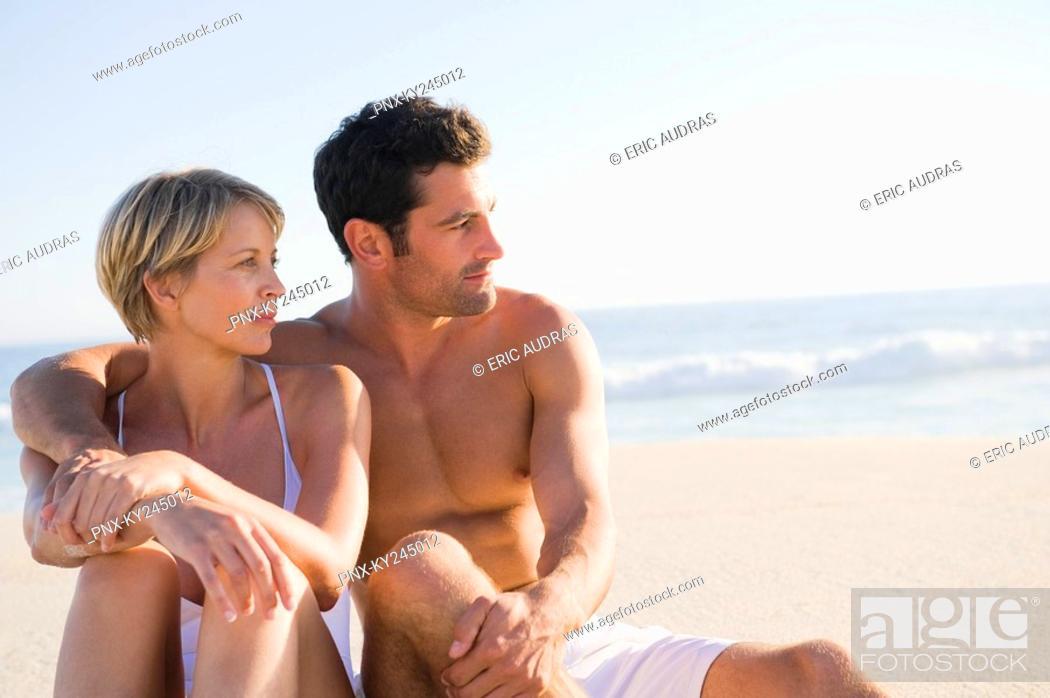 Stock Photo: Couple sitting on the beach.