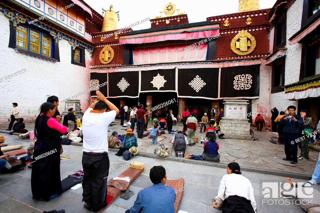 Stock Photo: People Bow before the Jokhang Temple.
